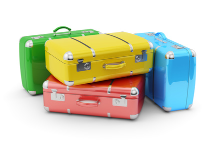 Travel and vacation concept, stack of colorful suitcases isolated on white background