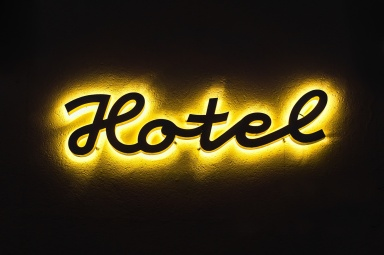 Illuminated hotel sign on the building