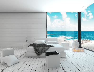 White bedroom interior in a maritime style and sea view